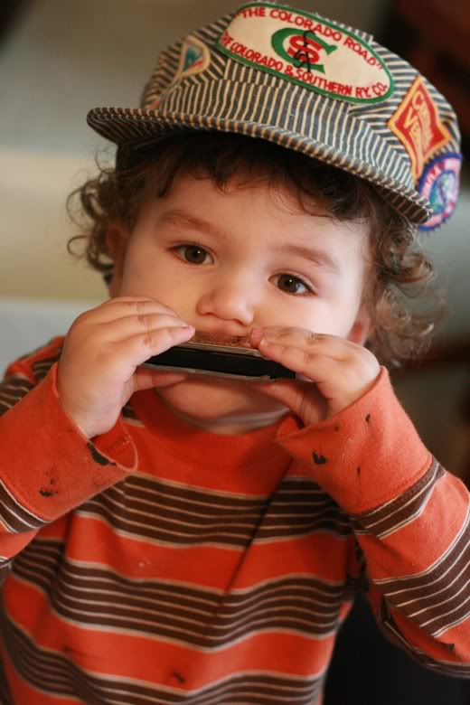 Hobo Baby with train conductor's hat and harmonica