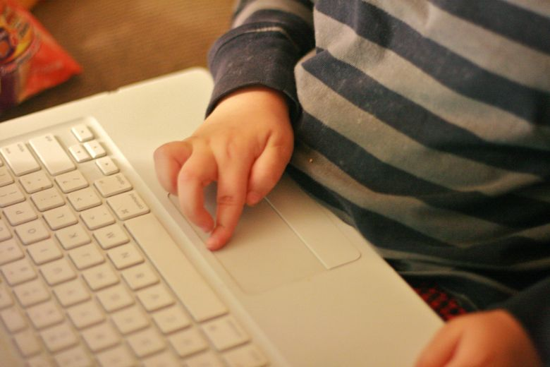 boy blogger's fingers on laptop