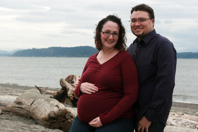 pregnant couple — family maternity photo shoot on the beach