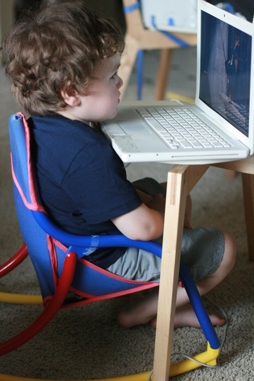 preschooler boy sits too close to the computer laptop screen — mikko 4 years old 4yo m4yo