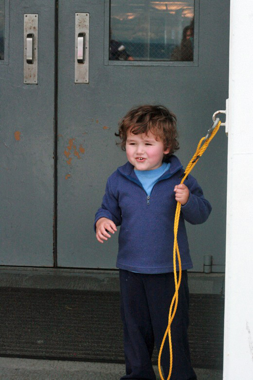 Liberty Bay boating outdoors — mikko m4yo holding onto rope on ferry
