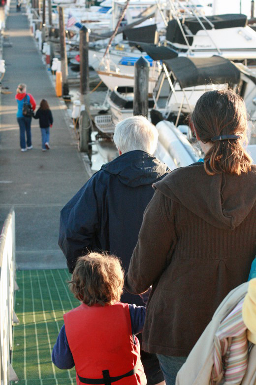 Liberty Bay boating outdoors — family walking down gangplank