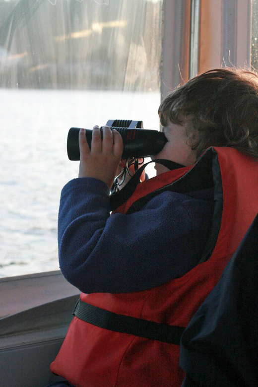 Liberty Bay boating outdoors — mikko m4yo using binoculars out window of boat