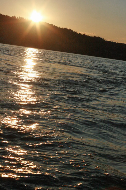 Liberty Bay boating outdoors — sunset over the water