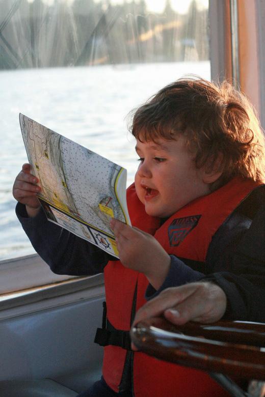 Liberty Bay boating outdoors — mikko m4yo reading map