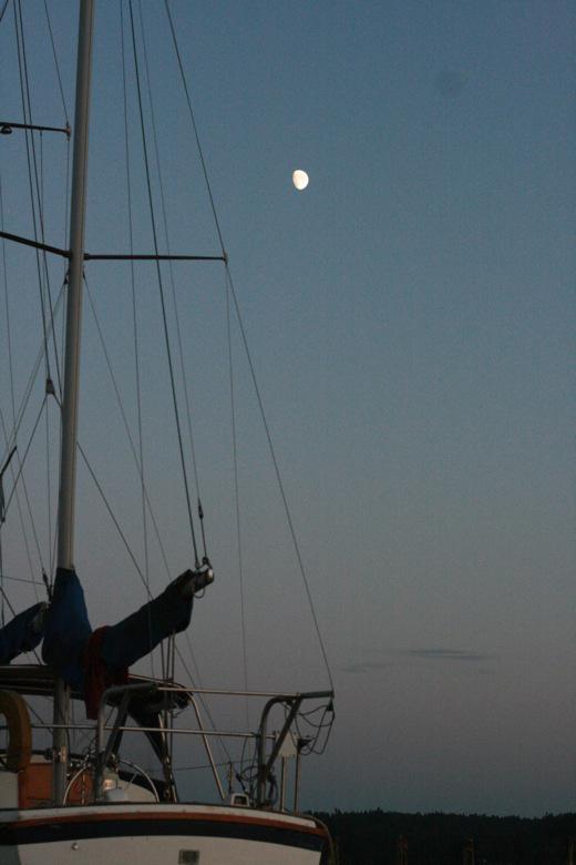 Liberty Bay boating outdoors — moonrise over a sailboat