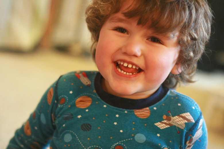 boy smiling in jammies