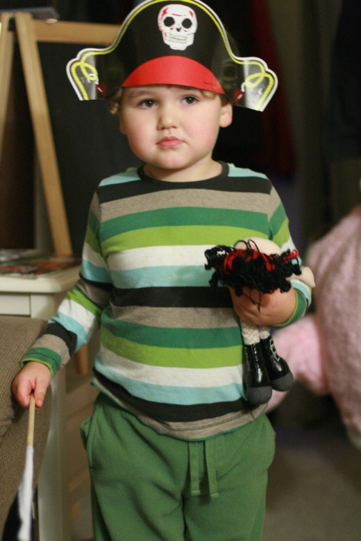 boy dressed in pirate hat