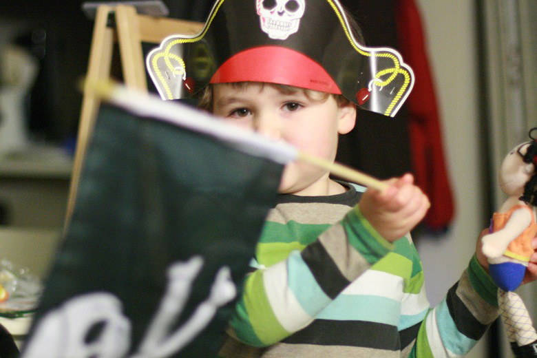 boy waving pirate flag