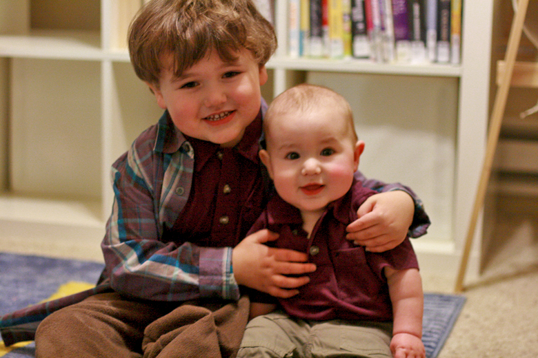boy and baby in Fuerte polo shirts, Fiesta plaid shirt, Surplus Playwear Pants — Tea Collection giveaway