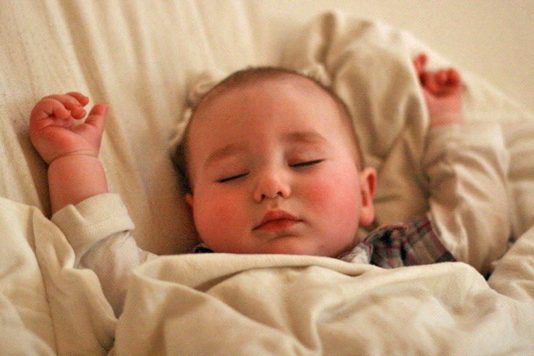 baby sleeping with arms up — cosleeping