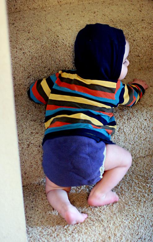 baby in stripy hoodie —alrik a10mo