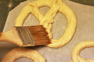 brushing on wash - cooking homemade soft pretzels