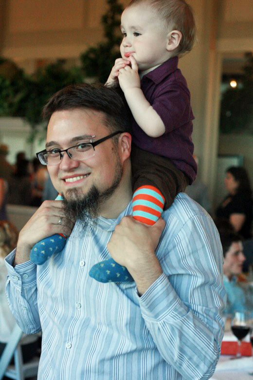 dad and baby on shoulders at wedding