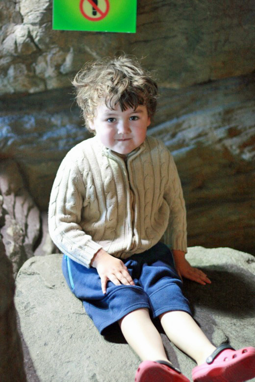 boy climbing rocks at the aquarium of the bay — california road trip travel san francisco