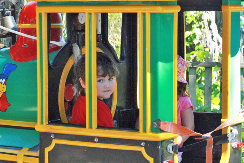 boy on amusement park train ride —Six Flags California