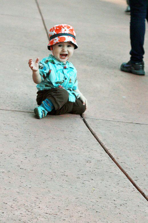baby crawling on sidewalk —Six Flags California