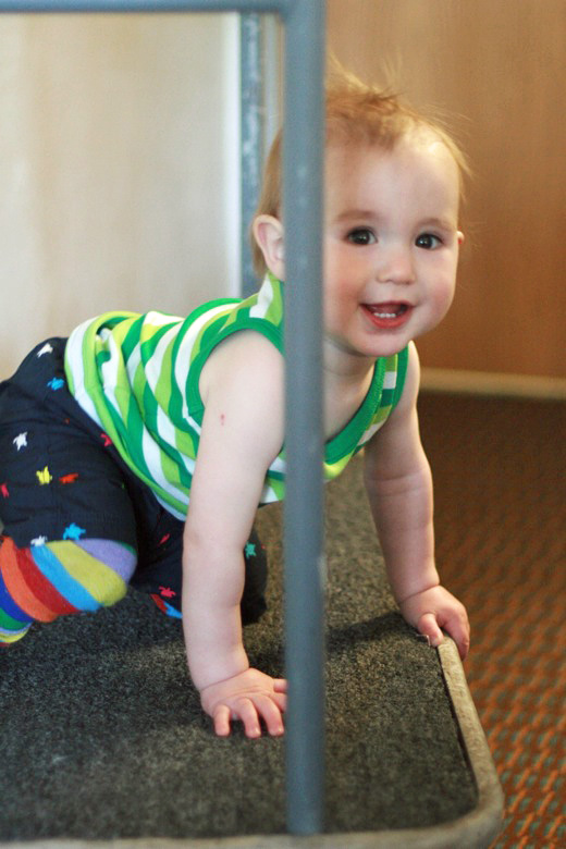 baby on a luggage cart — California road trip travel alrik a1yo a12mo