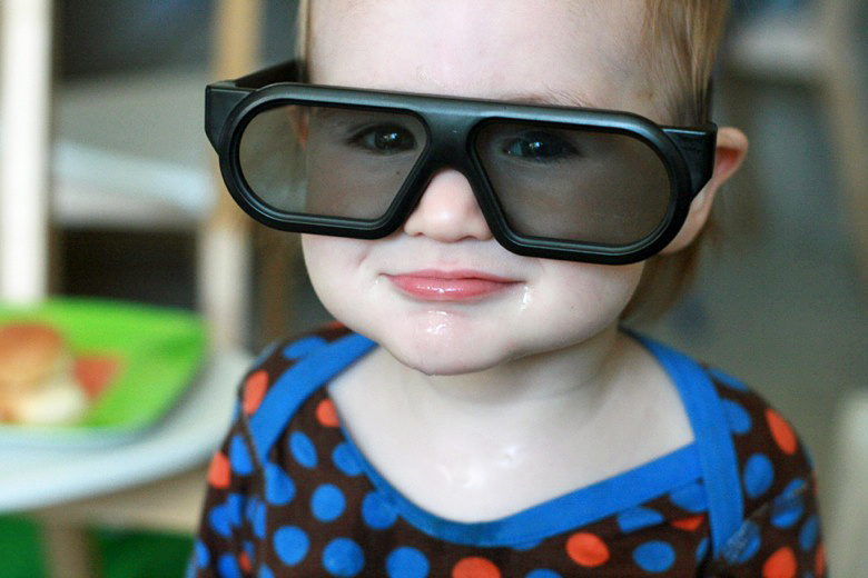 cool dude - toddler in huge 3D sunglasses