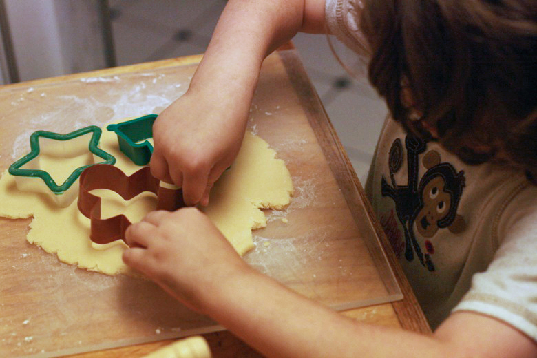 cutting out sugar cookies batter —