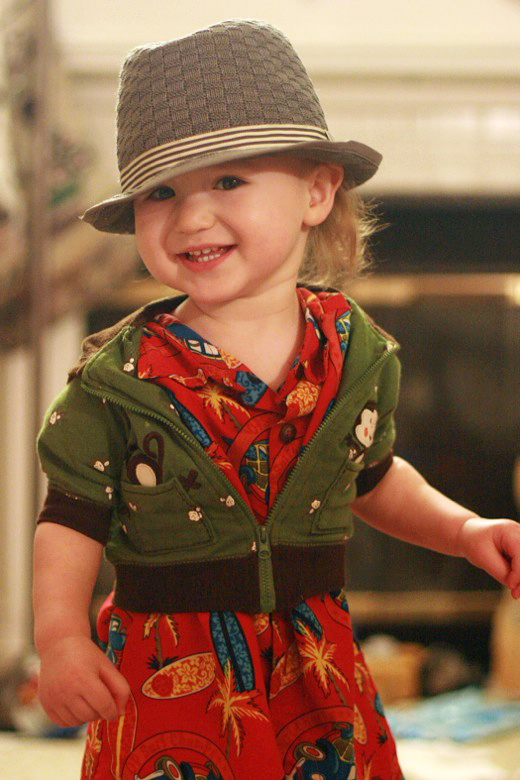 toddler modeling his own unique outfit of hawaiian shirt hoodie and fedora —