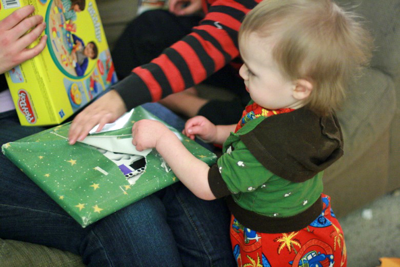 opening Christmas Eve presents of book —