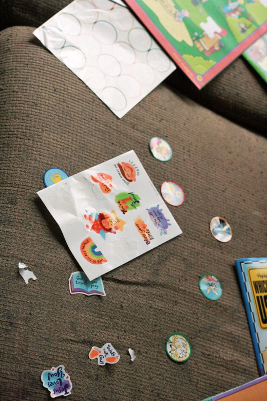 toddler's sticker artwork on the couch - crafts art