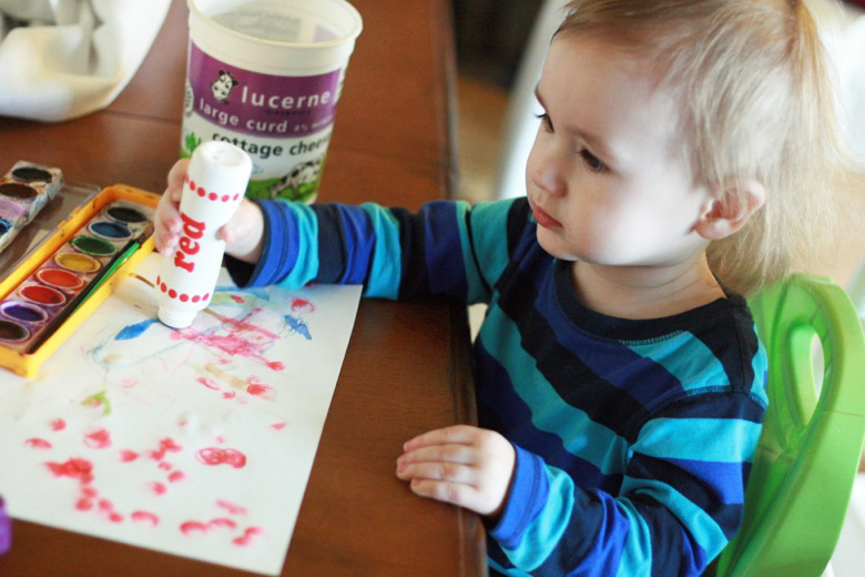 toddler painting with dot paint sticks at table - crafts art