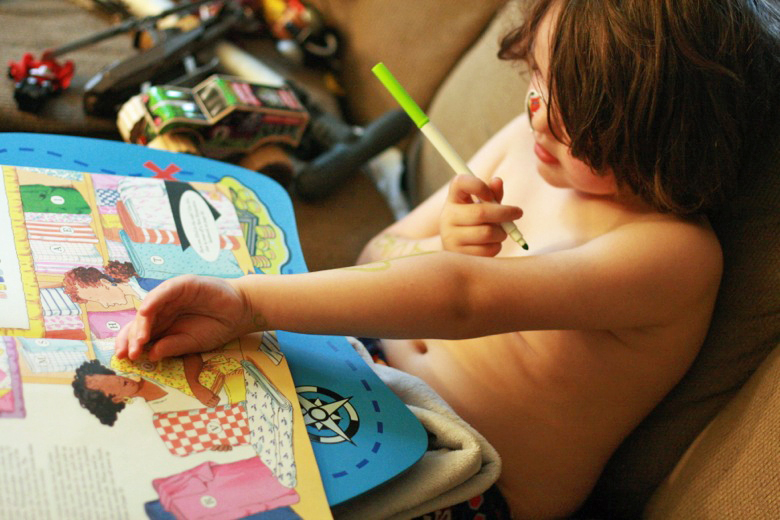 boy drawing crib sheet on arms with marker - crafts art