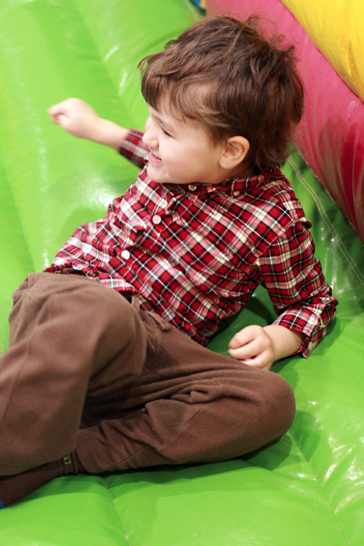 boy enjoying bouncy house at carnival at toddler play gym community center - Easter 2013 holidays