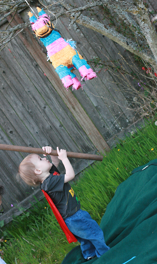 toddler boy hitting pinata - Easter 2013 holidays