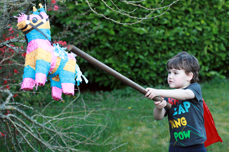 boy hitting pinata - Easter 2013 holidays