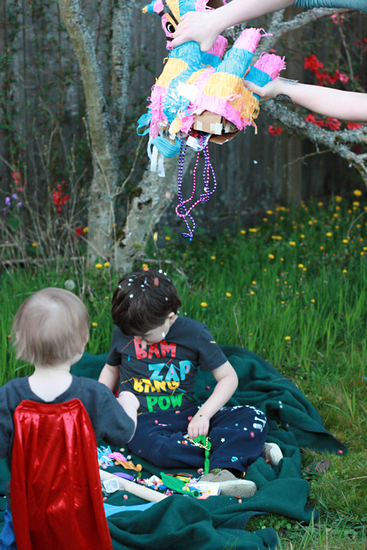 brothers getting showered by pinata prizes - Easter 2013 holidays