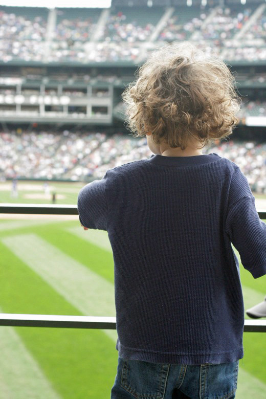 boy watches baseball ballfield at Safeco Field