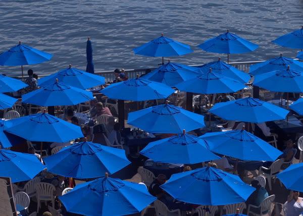 umbrellas at cafe below Seattle Great Wheel outdoors