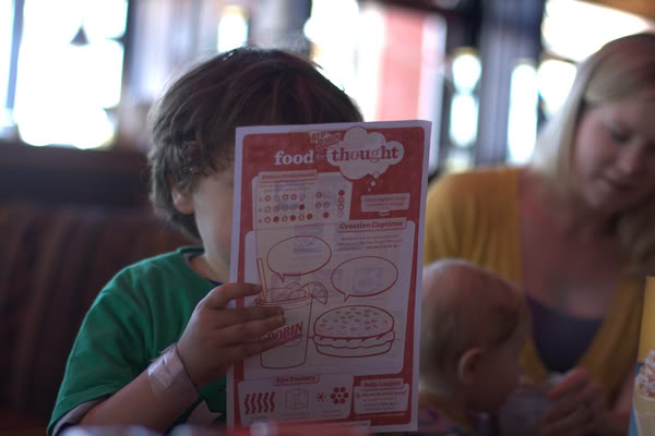 boy reading kids menu at Red Robin in downtown Seattle — mikko m5yo
