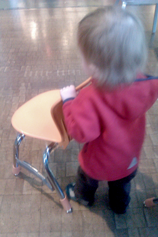 pushing a chair around the armory - pacific science center outing seattle unschooling
