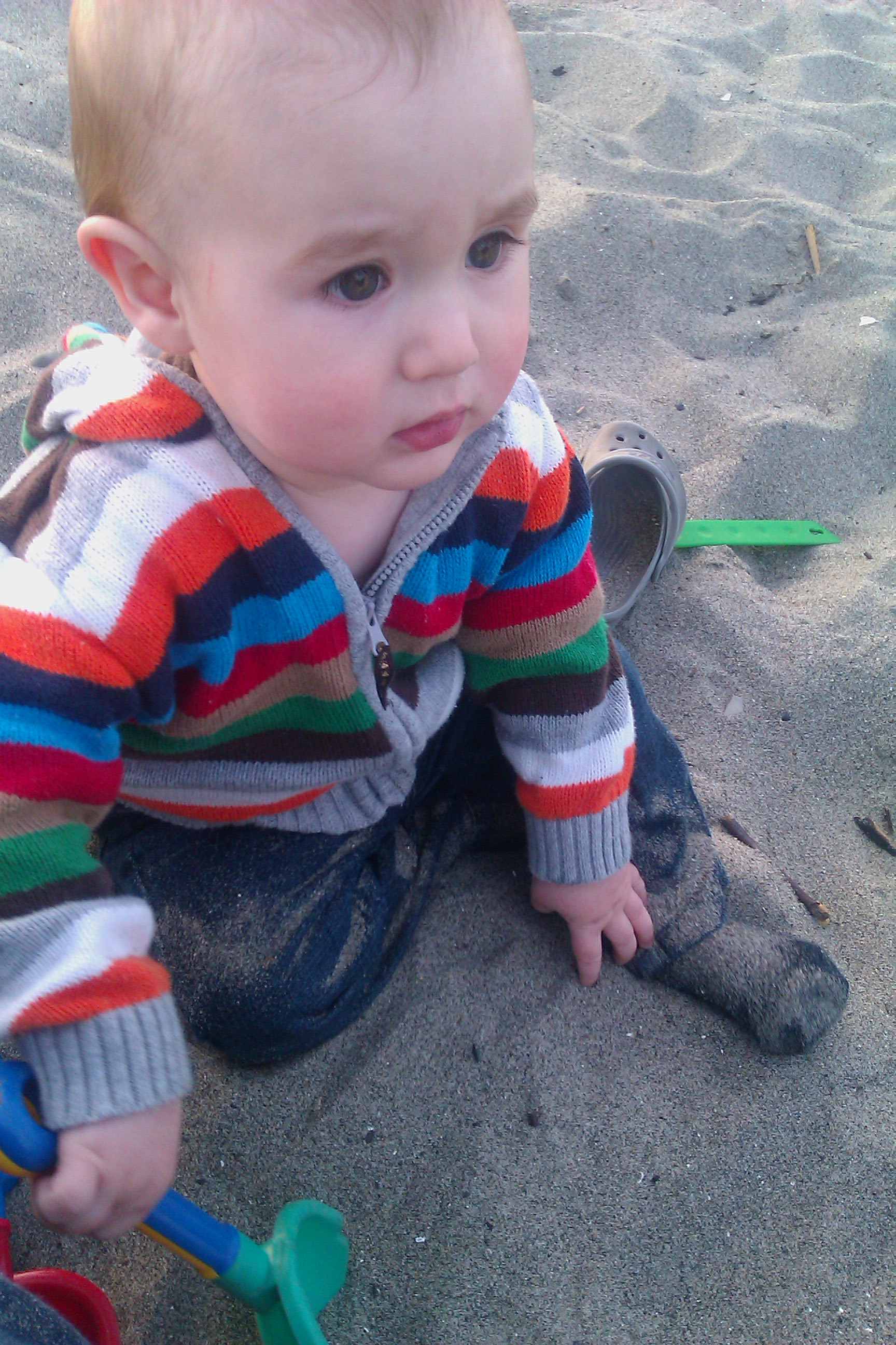 baby crawling on the beach