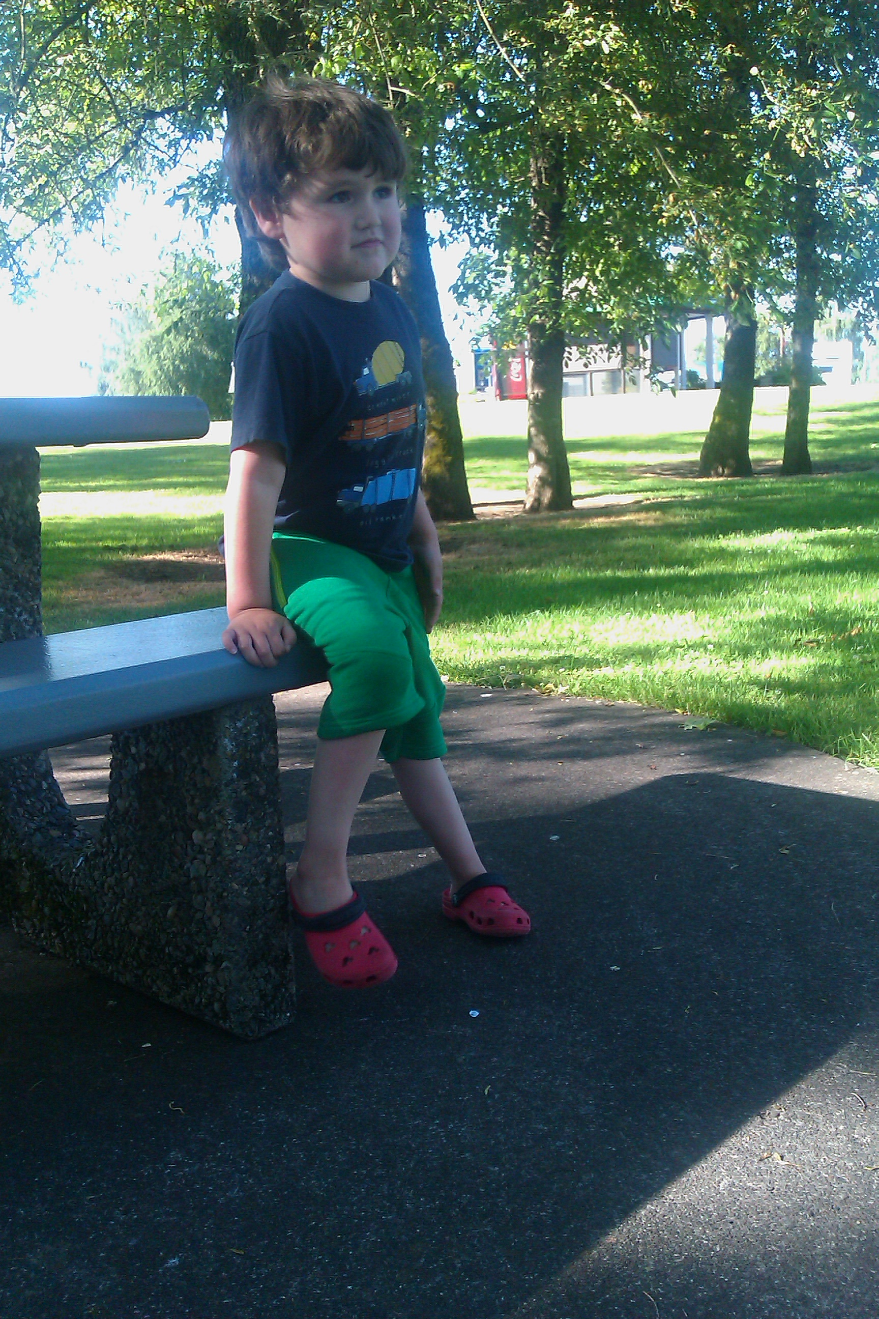 boy on bench at rest stop