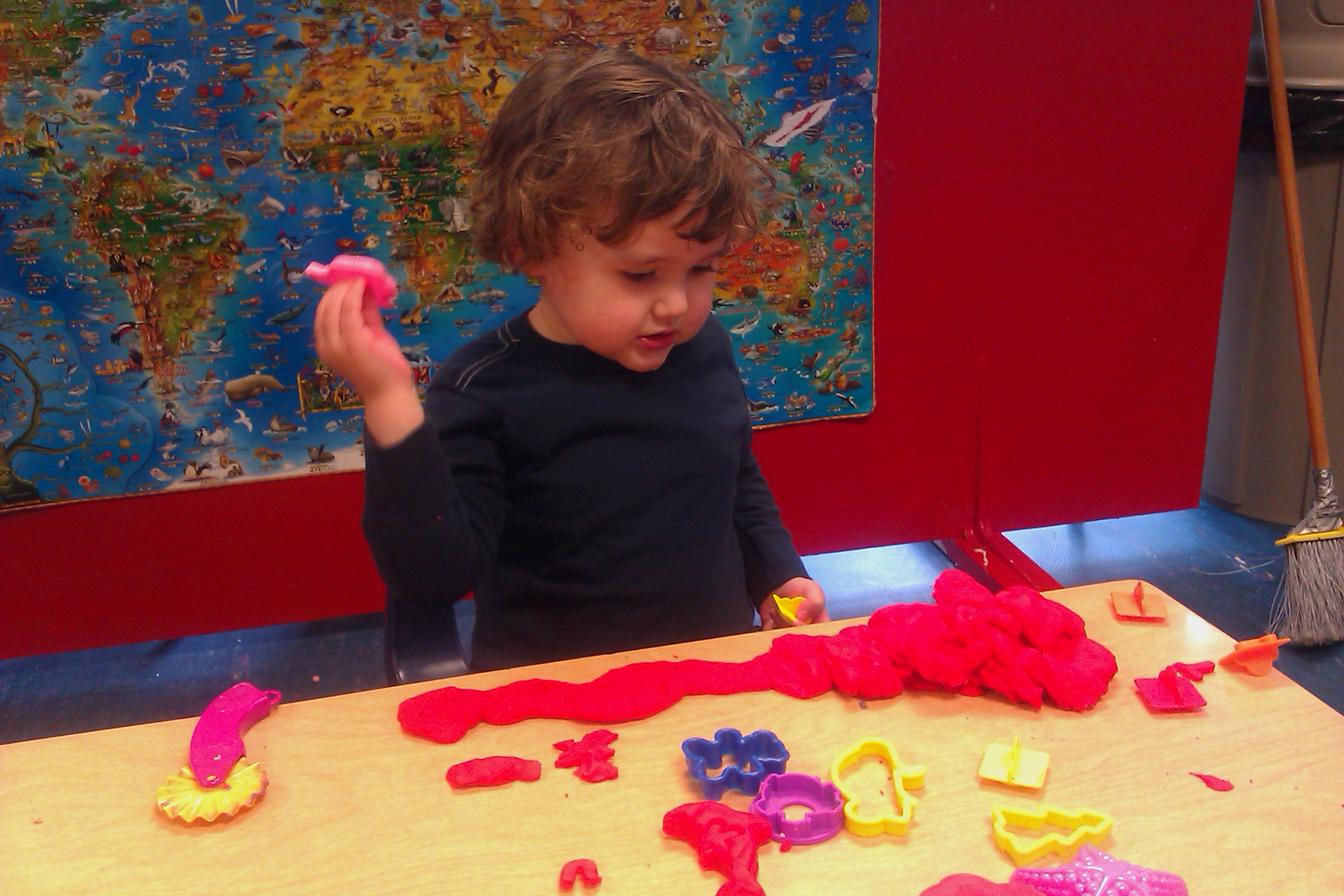 boy at preschool playing with play-doh