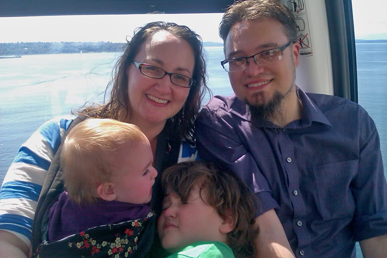 family on Seattle Great Wheel downtown — me sam mikko alrik m5yo a1yo a14mo