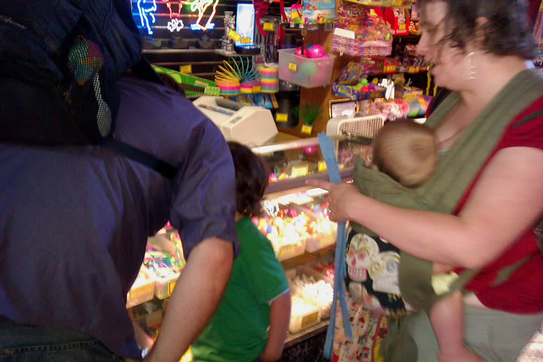 picking out prizes at Seattle downtown waterfront arcade — mikko m5yo moira davis babywearing shannon sam