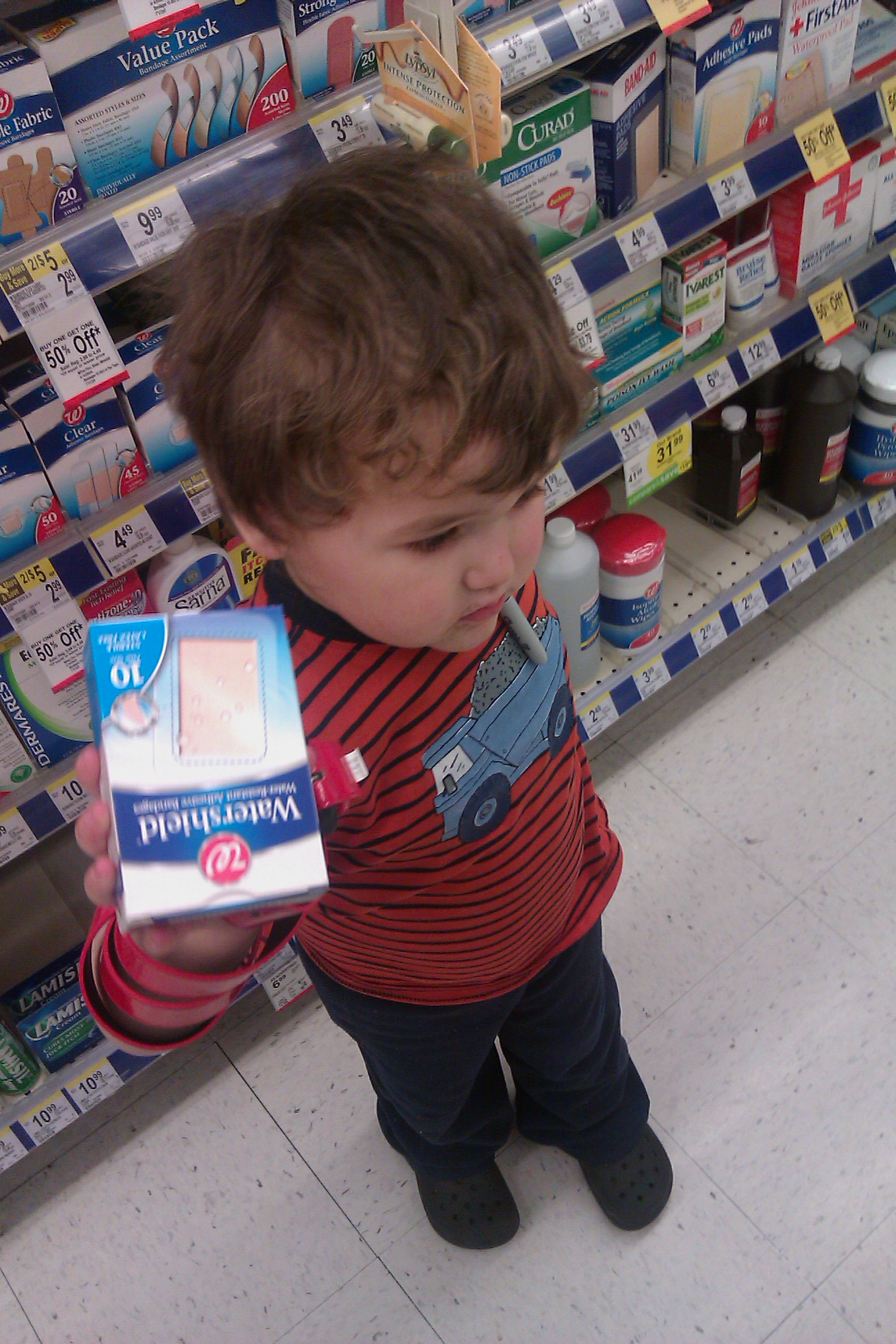 boy at Walgreens with Watershield large bandages