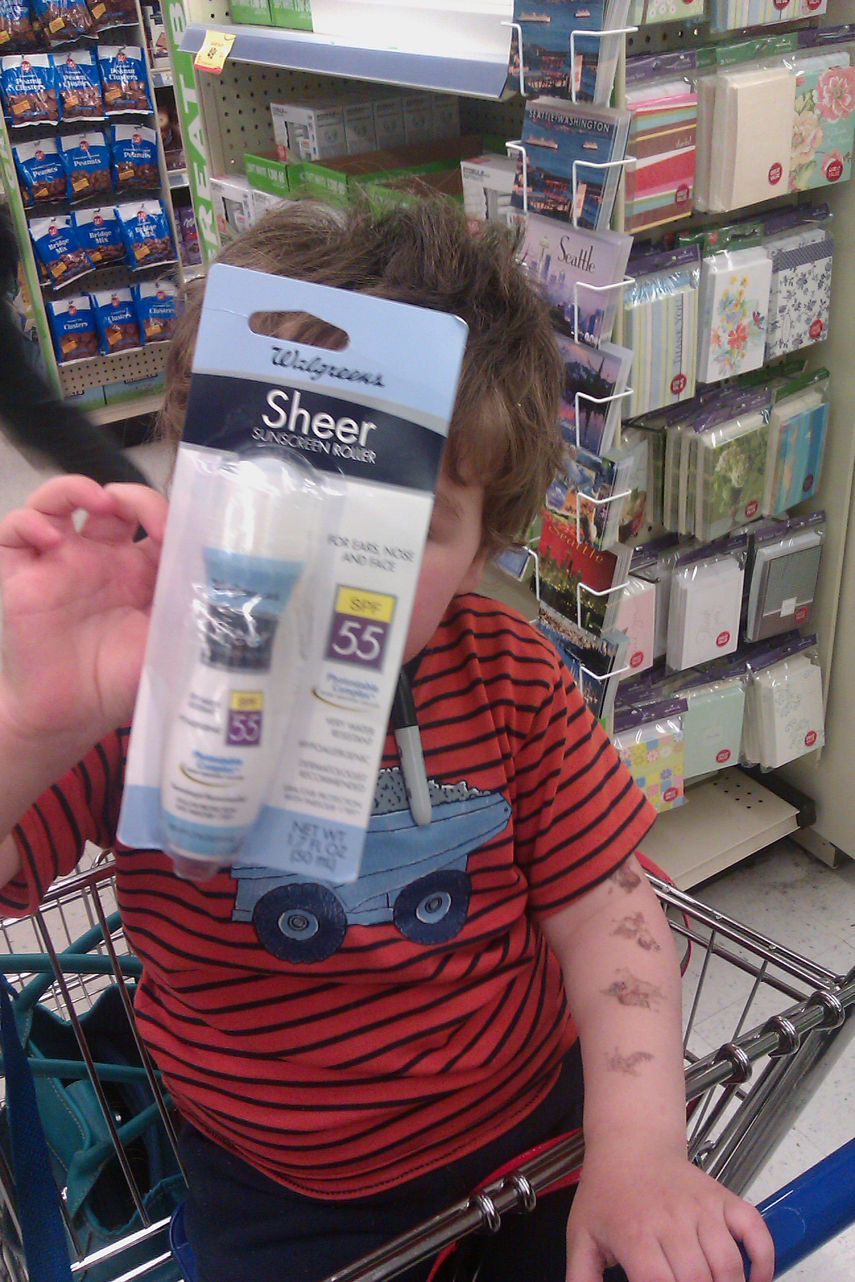 boy at Walgreens with Sheer Sunscreen Roller