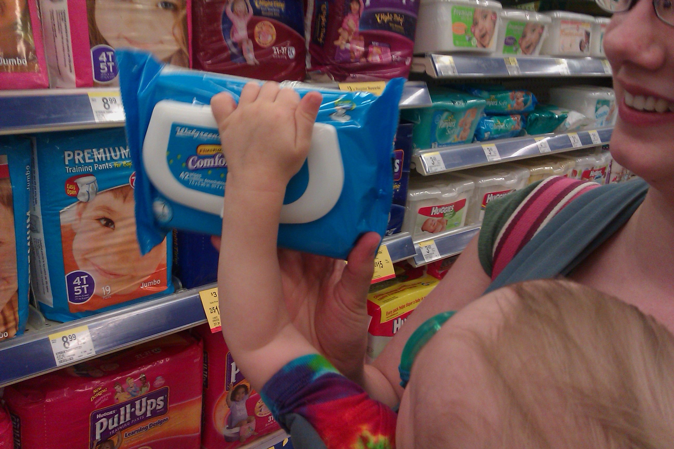 picking out flushable wipes with baby at Walgreens