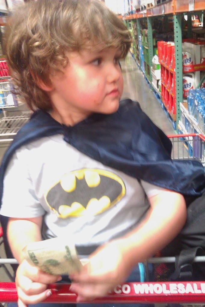 batman boy in shopping cart at costco