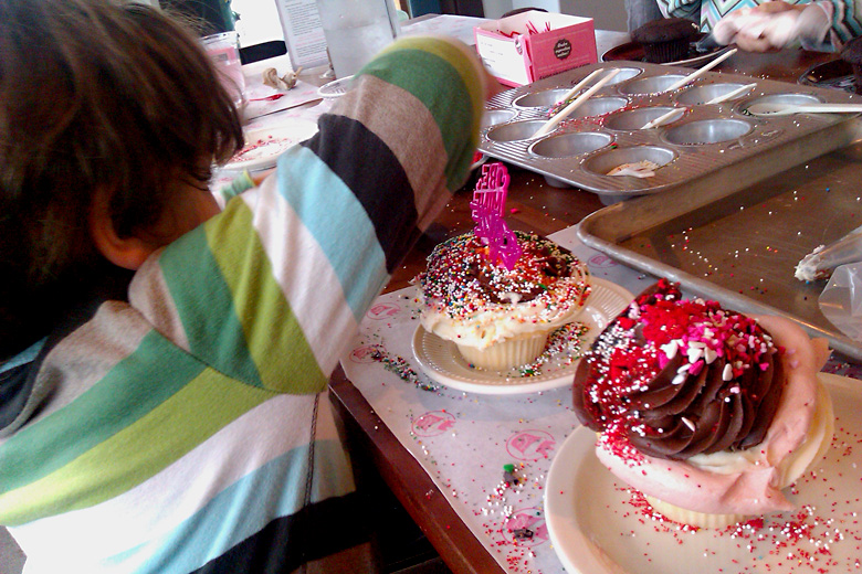 making cupcakes at Cupcake Royale Sprinkle Party — holidays Valentine's Day 2012