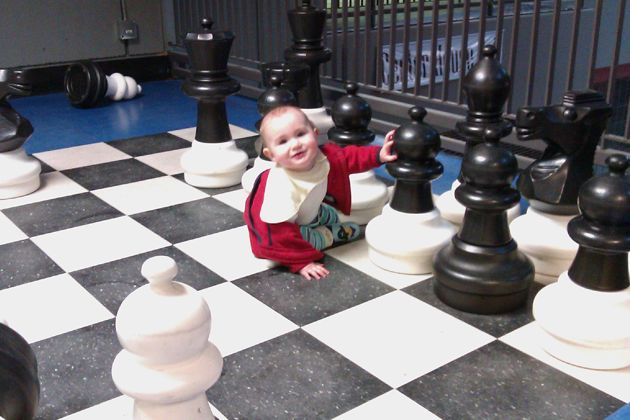 baby on giant chess board