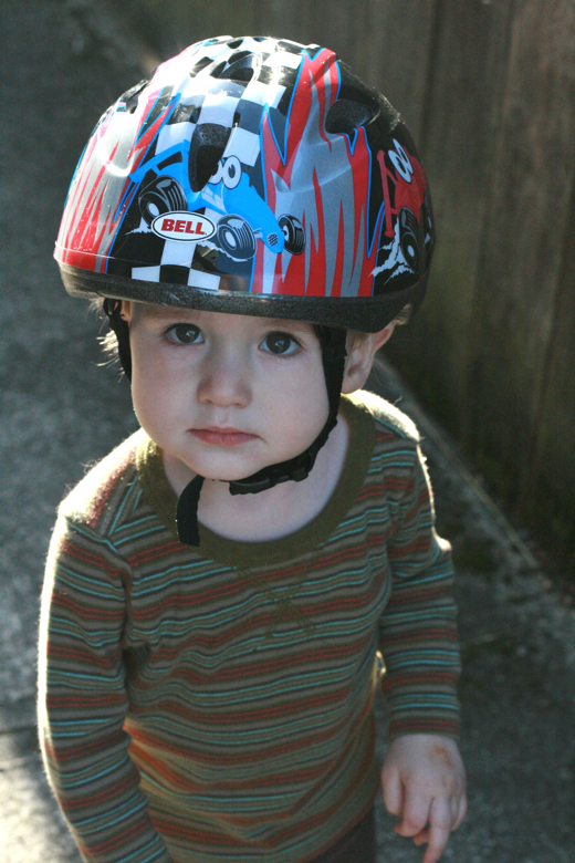 toddler boy in bike helmet - biking outdoors