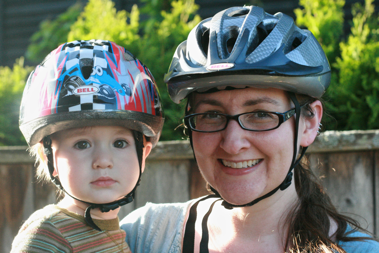 mom and toddler boy in bike helmet - biking outdoors